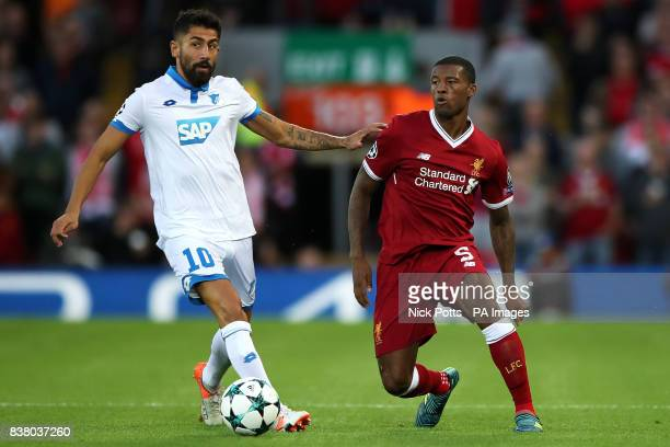 Hoffenheim's Kerem Demirbay and Liverpool's Georginio Wijnaldum in ation during the UEFA Champions League PlayOff Second Leg match at Anfield...