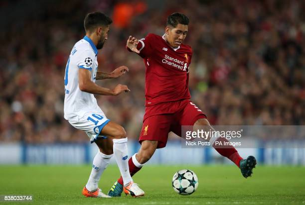 Hoffenheim's Kerem Demirbay and Liverpool's Roberto Firmino in action during the UEFA Champions League PlayOff Second Leg match at Anfield Liverpool
