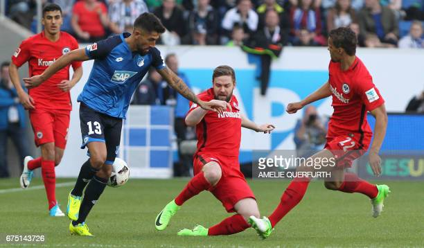 Hoffenheim's midfielder Kerem Demirbay vies for the ball with Frankfurt's midfielder Marc Stendera and Frankfurt's US defender Timothy Chandler...