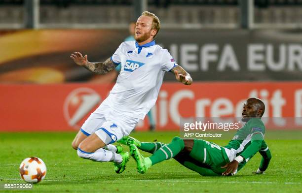 Hoffenheim's midfielder Kevin Vogt fights for the ball with Ludogorets's forward Jody Lukoki during the UEFA Europa League Group C football match...