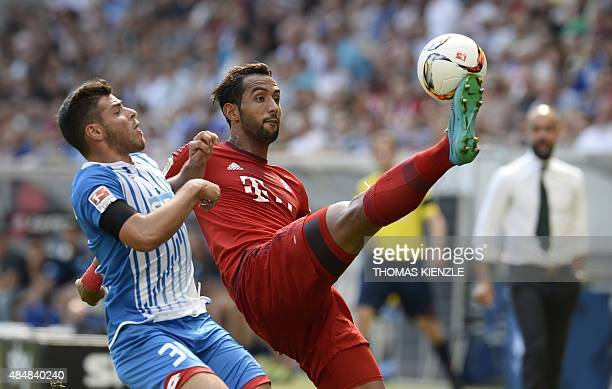 Hoffenheim's midfielder Kevin Volland and Bayern Munich's Moroccan defender Medhi Benatia vie for the ball during the German first division...