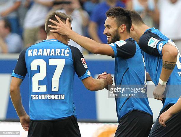 Hoffenheim's midfielder Lukas Rupp celebrates scoring the 10 with his teammates during the German first division Bundesliga football match of TSG...