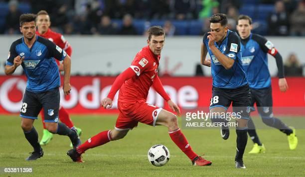 Hoffenheim's midfielder Marco Terrazzino and Hoffenheim's midfielder Nadiem Amiri vie for the ball with Mainz' defender Stefan Bell during the German...