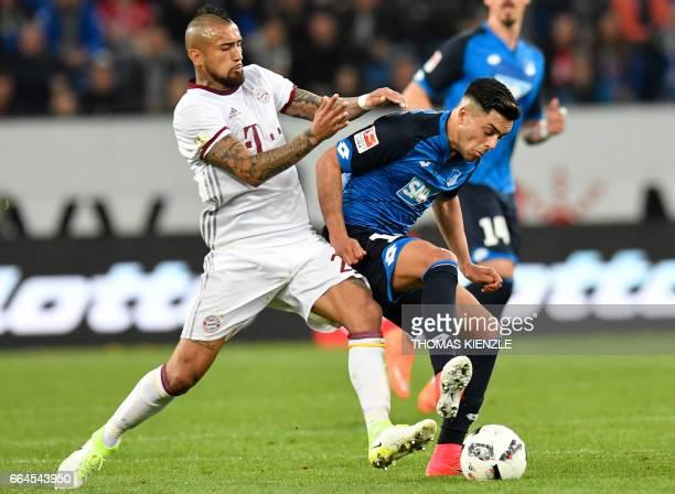 Hoffenheim's midfielder Nadiem Amiri and Bayern Munich's Chilean midfielder Arturo Vidal vie for the ball during the German First division Bundesliga...