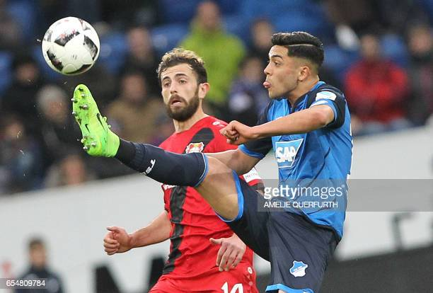 Hoffenheim's midfielder Nadiem Amiri and Leverkusen's Swiss forward Admir Mehmedi vie for the ball during the German First division Bundesliga...