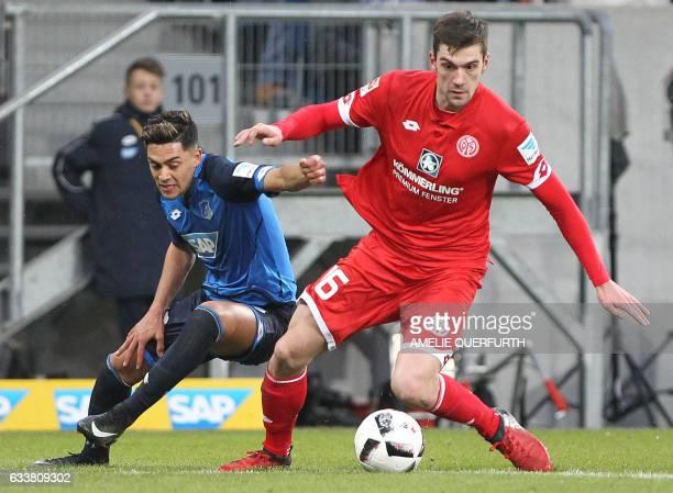 Hoffenheim's midfielder Nadiem Amiri and Mainz' defender Niko Bungert vie for the ball during the German first division Bundesliga football match TSG...