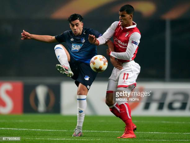 Hoffenheim's midfielder Nadiem Amiri vies with Sporting Braga's Brazilian midfielder Danilo Silva during the Europa League football match SC Braga vs...