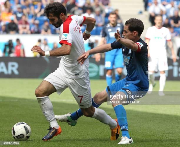 Hoffenheim's midfielder Sebastian Rudy and Augsburg's Turkish midfielder Halil Altintop vie for the ball during the German first division football...