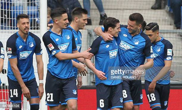 Hoffenheim's midfielder Sebastian Rudy celebrates scoring the 10 goal with his teammates during the German First division Bundesliga football match...