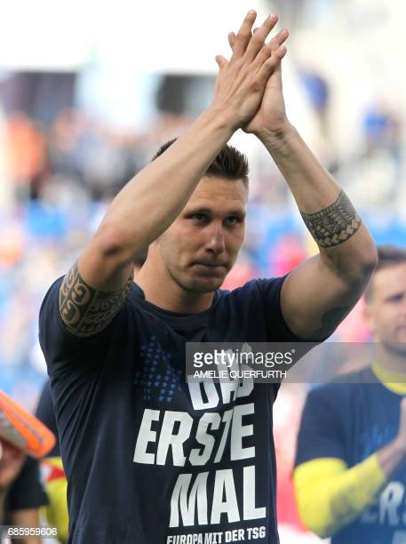Hoffenheim's midfielder Sebastian Rudy reacts after the German first division football match between TSG Hoffenheim 1899 and FC Augsburg on May 20...
