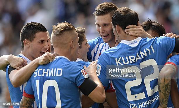Hoffenheim's player's celebrate after they scored during the German first division Bundesliga football match 1899 Hoffenheim vs FC Bayern Munich on...