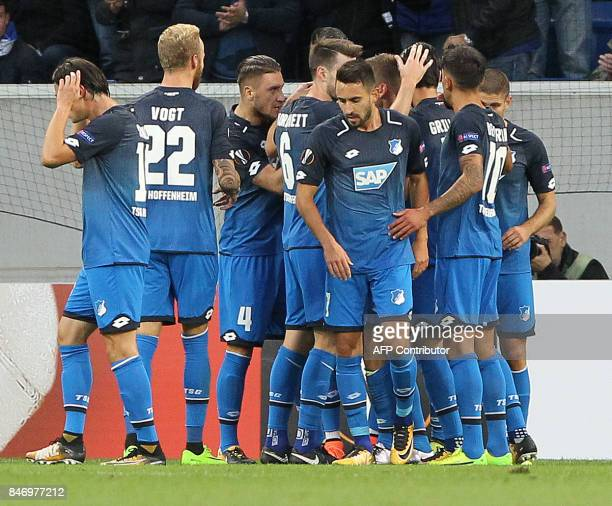 Hoffenheim's players celebrate scoring the opening goal during the UEFA Europa League group C fotball match TSG 1899 Hoffenheim v Sporting Braga in...