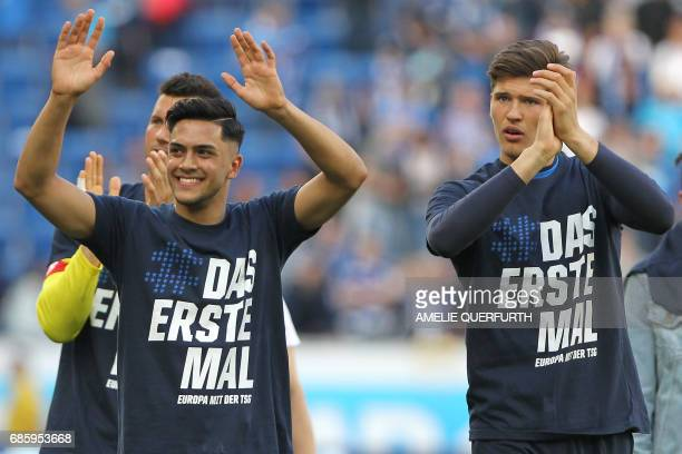 Hoffenheim's players react after the German first division football match between TSG Hoffenheim 1899 and FC Augsburg on May 20 2017 in Sinsheim...