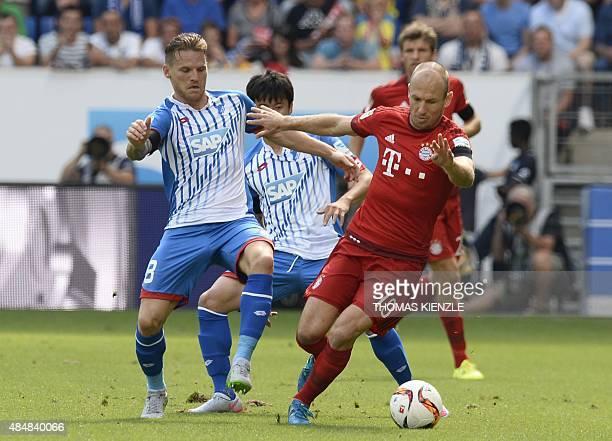 Hoffenheim's Polish midfielder Eugen Polanski and Bayern Munich's Dutch midfielder Arjen Robben vie for the ball during the German first division...