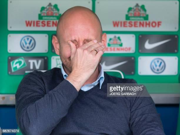 Hoffenheim's sports director Alexander Rosen reacts prior to the German first division Bundesliga football match between Werder Bremen and TSG...