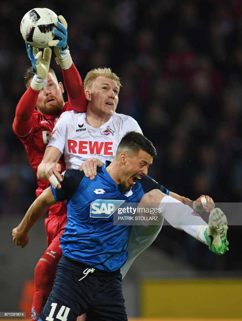Hoffenheim's striker Sandro Wagner , Cologne's goalkeeper Timo Horn and Cologne's Danish defender Frederik Soerensen vie for the ball during the German first division Bundesliga football match of 1.FC Cologne vs TSG Hoffenheim in Cologne, western Germany, on April 21, 2017. /