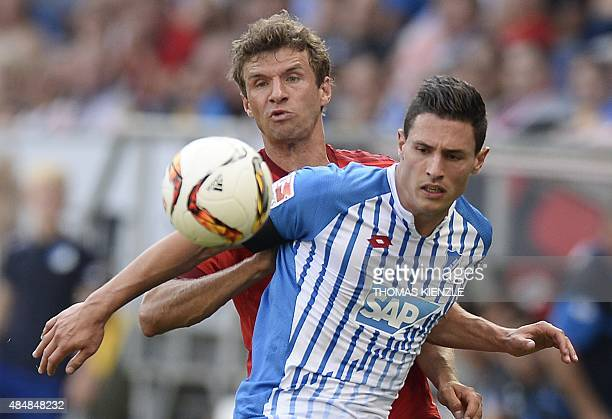 Hoffenheim's Swiss defender Fabian Schaer and Bayern Munich's forward Thomas Mueller vie for the ball during the German first division Bundesliga...