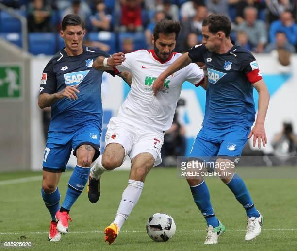 Hoffenheim's Swiss midfielder Steven Zuber and Hoffenheim's midfielder Sebastian Rudy and Augsburg's Turkish midfielder Halil Altintop vie for the...