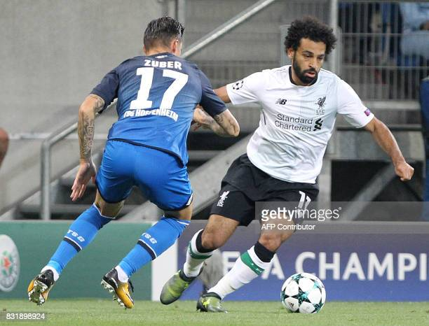 Hoffenheim's Swiss midfielder Steven Zuber and Liverpool's forward Mohamed Salah vie for the ball during the Champions League football qualifier...