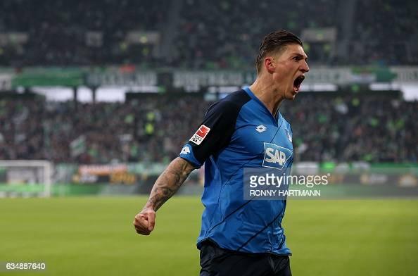 Hoffenheim's Swiss midfielder Steven Zuber celebrates after scoring the opening goal during the German First division Bundesliga football match...