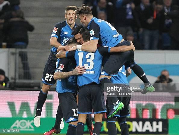 Hoffenheim's Swiss midfielder Steven Zuber celebrates scoring the 21 goal with his teammates during the German first division Bundesliga football...