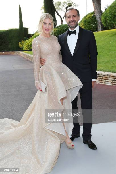 Hofit Golan and Elias Sacal Cababie arrive at the amfAR Gala Cannes 2017 at Hotel du CapEdenRoc on May 25 2017 in Cap d'Antibes France