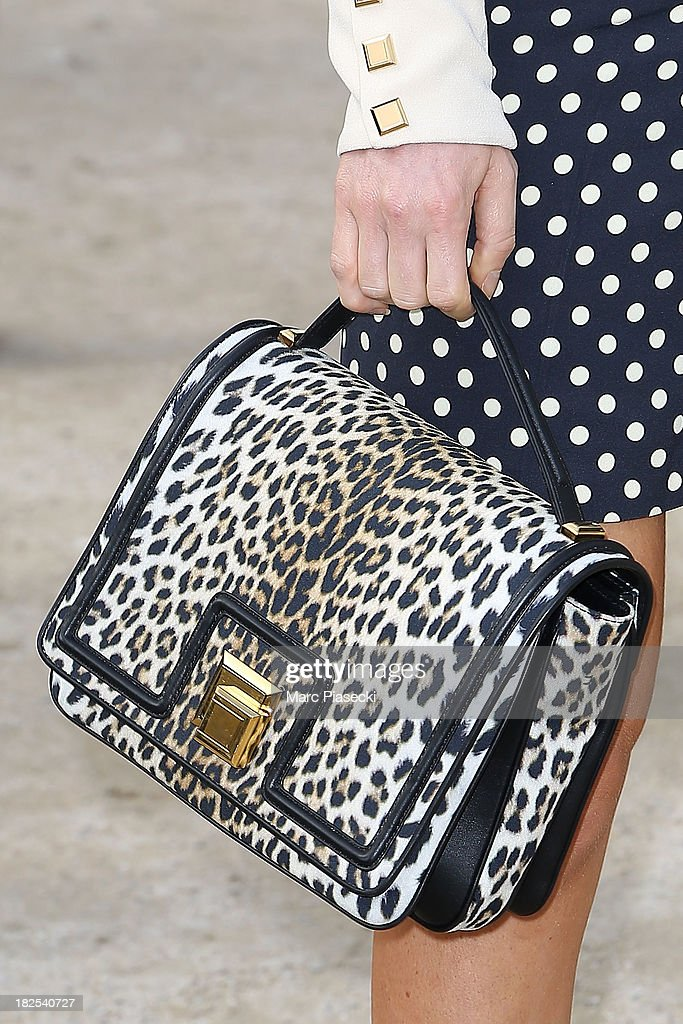 <a gi-track='captionPersonalityLinkClicked' href=/galleries/search?phrase=Hofit+Golan&family=editorial&specificpeople=542603 ng-click='$event.stopPropagation()'>Hofit Golan</a> (handbag detail) attends the Elie Saab show as part of the Paris Fashion Week Womenswear Spring/Summer 2014 on September 30, 2013 in Paris, France.