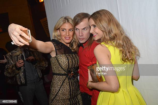 Hofit Golan Christophe GuillarmeÊand Sophie HermannÊpose for a selfie during the Christophe Guillarme show as part of the Paris Fashion Week...