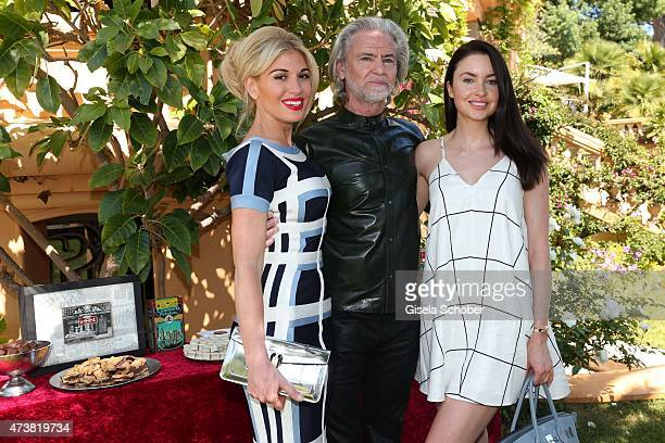 Hofit Golan Dr Hermann Buehlbecker sole owner of Lambertz Group Sponsor and Member of the Event Committee Emma Miller during the Hollywood Domino...
