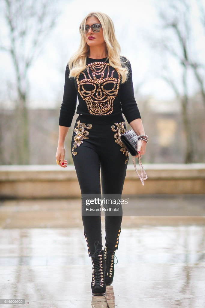Hofit Golan wears a black top with a printed golden skull, black pants, outside the Rochas show, during Paris Fashion Week Womenswear Fall/Winter 2017/2018, on March 1, 2017 in Paris, France.