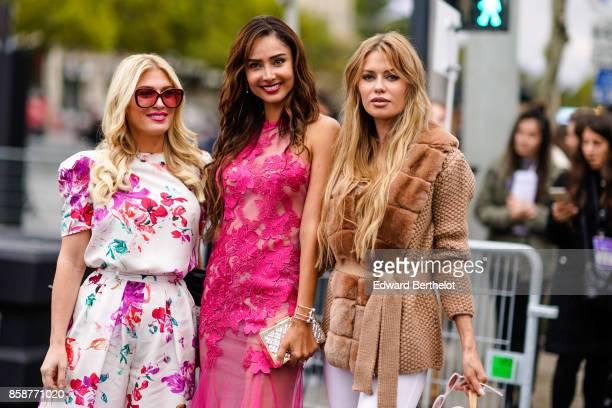 Hofit Golan wears a floral print dress and Patricia Contreras wears a pink dress outside Le Defile L'Oreal Paris as part of Paris Fashion Week...