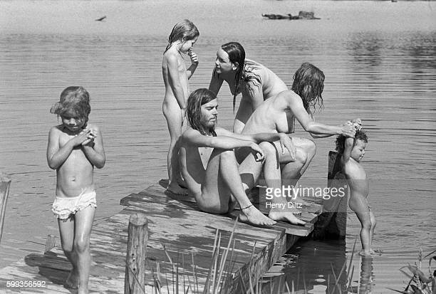 Hog Farm members cool off in a lake as they travel to the free Woodstock Music and Art Fair About 450000 people attended the three day concert which...