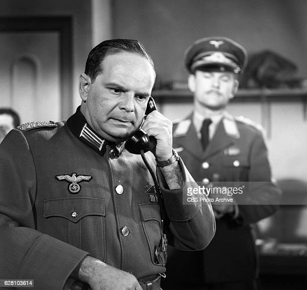 Hogan's Heroes episode Happy Birthday Adolf Pictured from left is Howard Caine and Bob Crane disguised as German army Major Hoganborg Image dated...