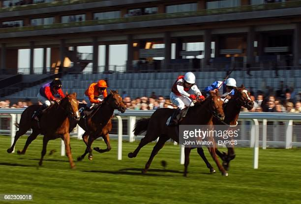 Hoh Mike ridden by Jamie Spencer comes home to win The waterhomescom Pavilion Stakes ahead of Hinton Admiral ridden by jockey JeanPierre Guillambert