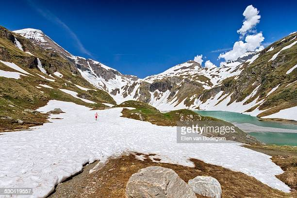 Hohe Tauern mountain landscape with person in snow