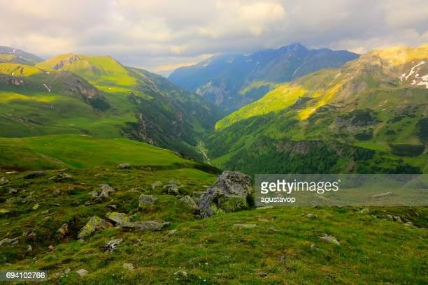 Hohe Tauern Snowcapped Austrian mountain range - Tirol Alps dramatic cloudscape Sky and landscape and Grossglockner Massif