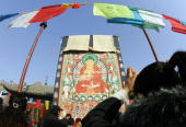 A giant thangka is unfurled for worshippers at the Dazhao temple in Hohhot 12 February 2006 where ethnicMongolian monks from the YellowHat sect of...
