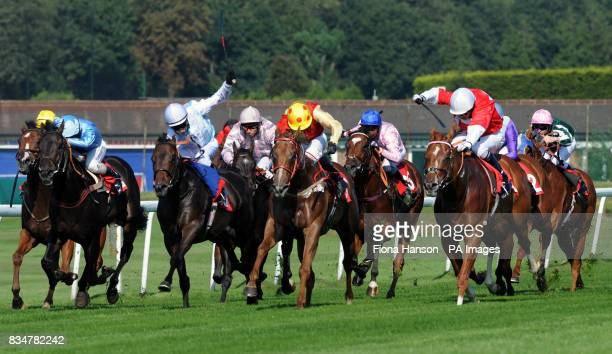 HoHoHo ridden by Jim Crowley winning the McGee Handicap Stakes from Crimson Fern ridden by T McLaughlin at Sandown Racecourse Esher