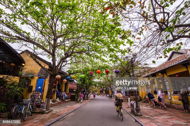 Hoi An Street Scene The Architecture of Hoi An together with the Chinese and Vietnamese architectural gems 19th century French colonial stucco houses...