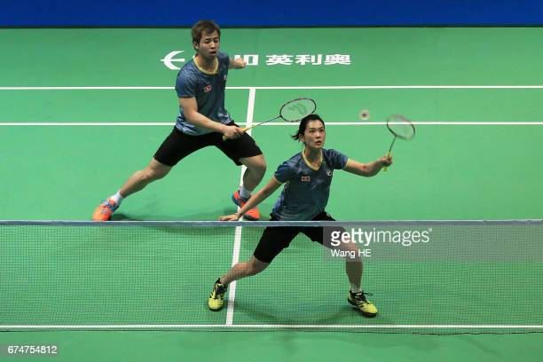 Hoi Wah hits a return next to her partner LEE Chun Hei Reginald during their mixed doubles semifinal match against LU Kai and Huang Yaqiong of China...