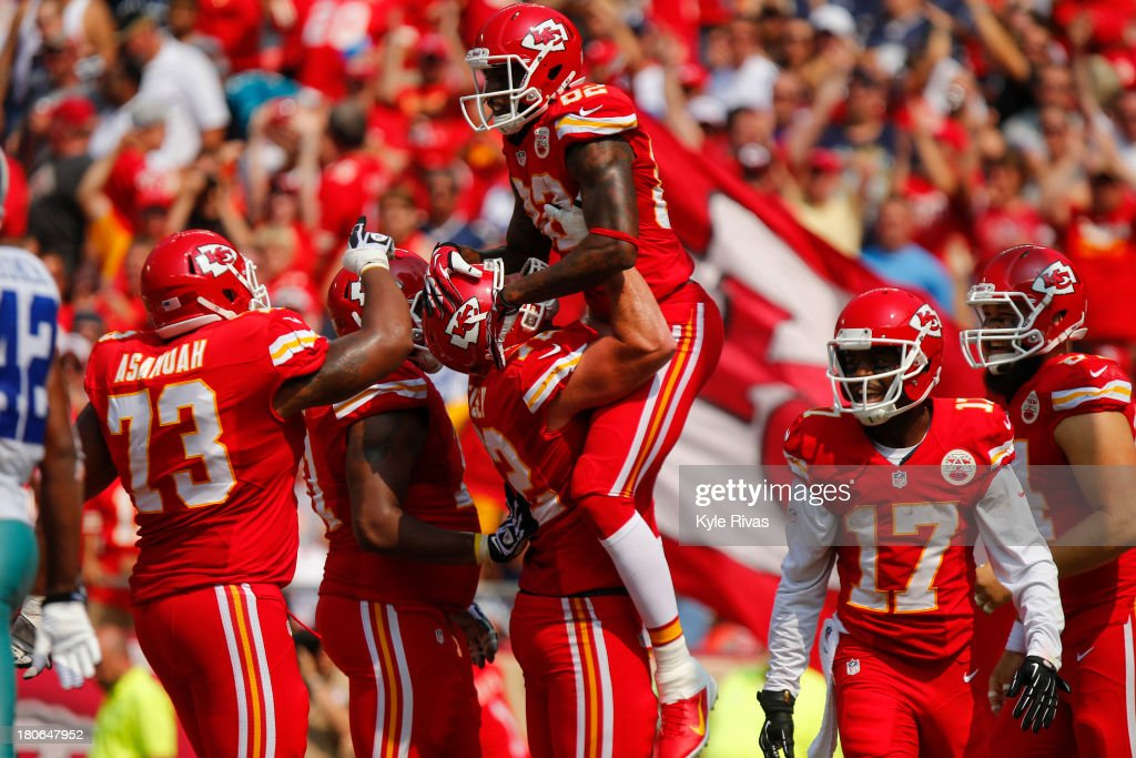 Hoisted into the air by Eric Fisher #72, <a gi-track='captionPersonalityLinkClicked' href=/galleries/search?phrase=Dwayne+Bowe&family=editorial&specificpeople=2139865 ng-click='$event.stopPropagation()'>Dwayne Bowe</a> #82 of the Kansas City Chiefs celebrates with the team after scoring a touchdown against the Dallas Cowboys in the third quarter on September 15, 2013 at Arrowhead Stadium in Kansas City, Missouri.
