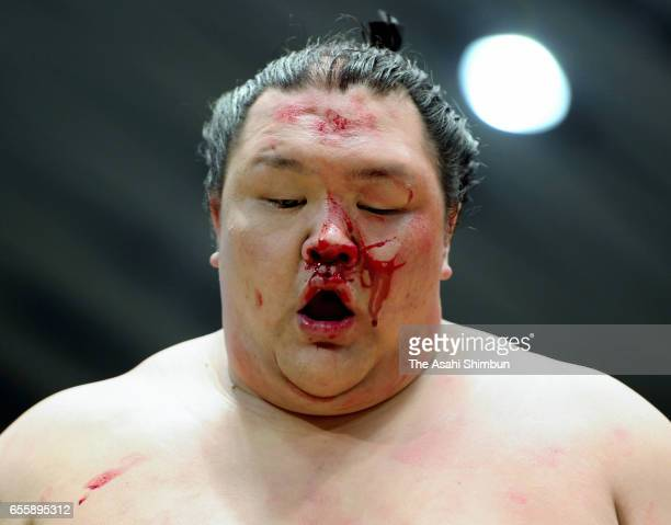 Hokutofuji reacts after his win over Mongolian wrestler Takanoiwa during day nine of the Grand Sumo Spring Tournament at Edion Arena Osaka on March...