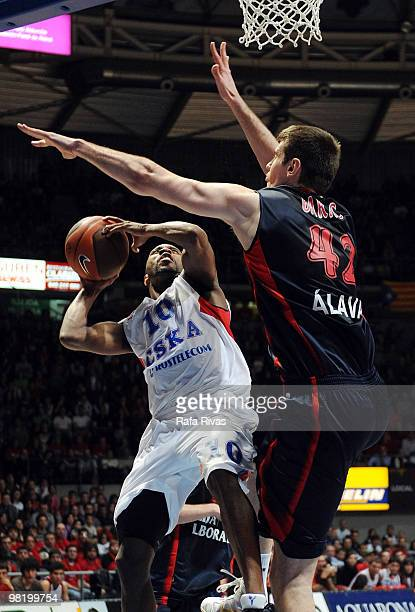 R Holden #10 of CSKA Moscow competes with Stanko Barac #42 of Caja Laboral during the Euroleague Basketball 20092010 Play Off Game 4 between Caja...