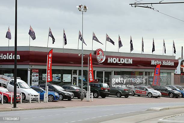 Holden cars stand for sale at a dealership at Thebarton on July 30 2013 in Adelaide Australia Holden a subsidiary of American car giant General...