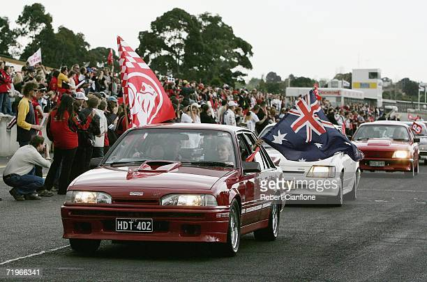 Holden fans do a lap of honor during the Peter Brock Memorial Service held at Sandown Raceway September 22 2006 in Melbourne Australia The memorial...