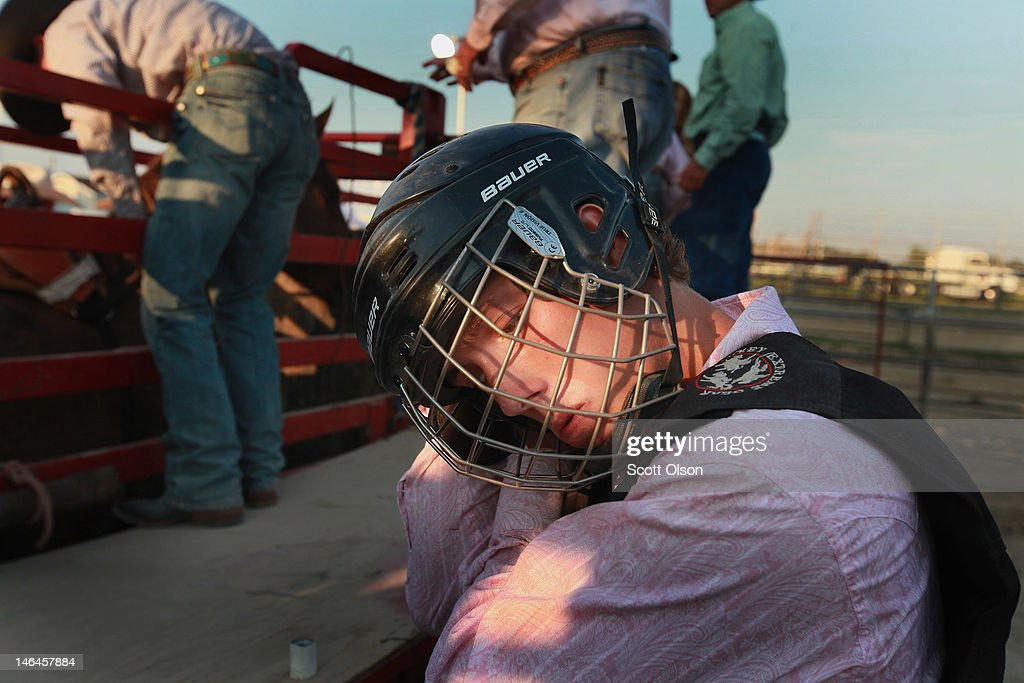 Holden LaLaVault prepares for his bronc ride at the Illinois High School Rodeo Association State Finals on June 16, 2012 in Altamont, Illinois. Winners in the competition will go on to compete in the high school national championships July 15-21 in Rock Springs, Wyoming.