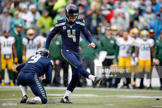 Holder Jon Ryan of the Seattle Seahawks keeps the ball on an attempted field goal and runs to throw a 19yard touchdown pass to Garry Gilliam in the...