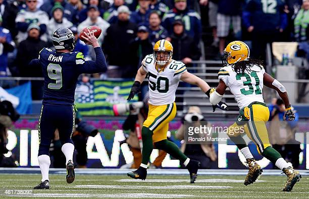 Holder Jon Ryan of the Seattle Seahawks throws a 19 yard touchdown pass to Garry Gilliam in the second half against the Green Bay Packers during the...