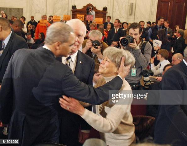 Holder receives a kiss from his mother Miriam before his confirmation hearing in front of the Senate Judiciary Committee on Capitol Hill on January...
