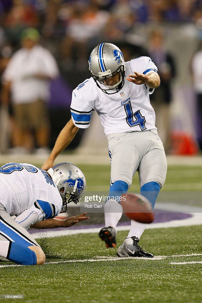 Holder Ryan Donahue #6 holds the ball as kicker <a gi-track='captionPersonalityLinkClicked' href=/galleries/search?phrase=Jason+Hanson&family=editorial&specificpeople=227006 ng-click='$event.stopPropagation()'>Jason Hanson</a> #4 of the Detroit Lions kicks a field goal against the Baltimore Ravens during the first half at M&T Bank Stadium on August 17, 2012 in Baltimore, Maryland.